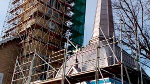 Delicate craftsmanship, rigging secures church steeple
