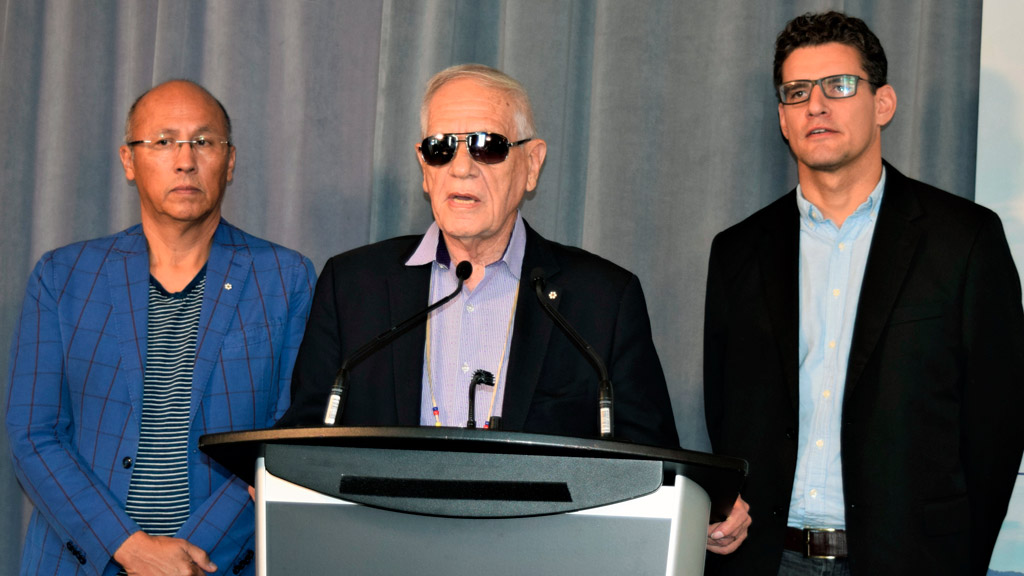 Indigenous architect Douglas Cardinal, centre, spoke at a Royal Architectural Institute of Canada event in Toronto last fall where it was announced he would lead Canada's team contributing to the 2018 Venice Architecture Biennale. He was flanked by co-curators Gerald McMaster, left, and David Fortin.