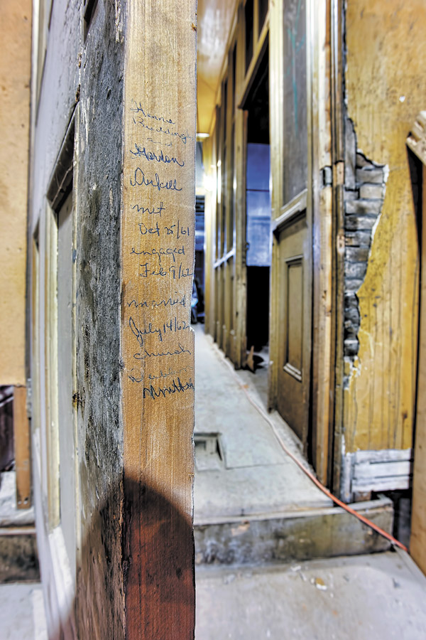 A couple who met at the Petrie Building in Guelph in the early 1960s wrote their engagement and marriage dates on the edge of a door frame. CAHP president Gerry Zegerius, a senior associate with Tacoma Engineers Inc., discovered it during an inspection and was able to track down the couple's children and send them a photo of it.