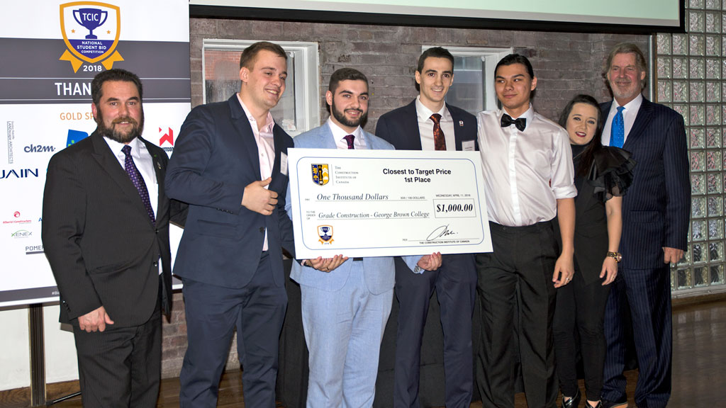 Grade Construction from George Brown College won third place in the BIM category and first place for being closest to the target price in The Construction Institute of Canada's annual Simulated Student Bid Competition. Team members Roman Solonynko, Juliano Nolfo, Alex Lema and Cameron Stitski accepted the awards at a ceremony at The Glass Factory in Toronto April 11.