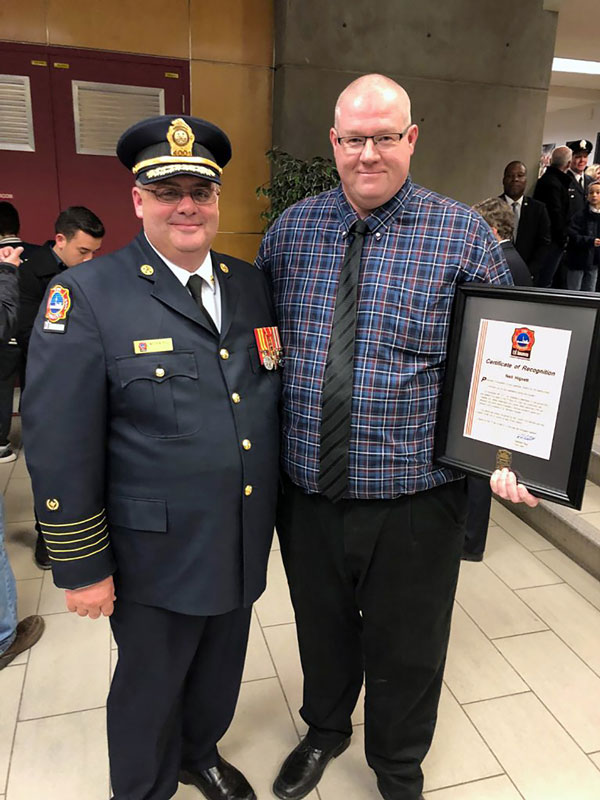 Neil Hignett, health, safety and environmental manager at EllisDon, was presented with a Certificate of Recognition by the Toronto Fire Services for helping to save a life following an incident on a jobsite.