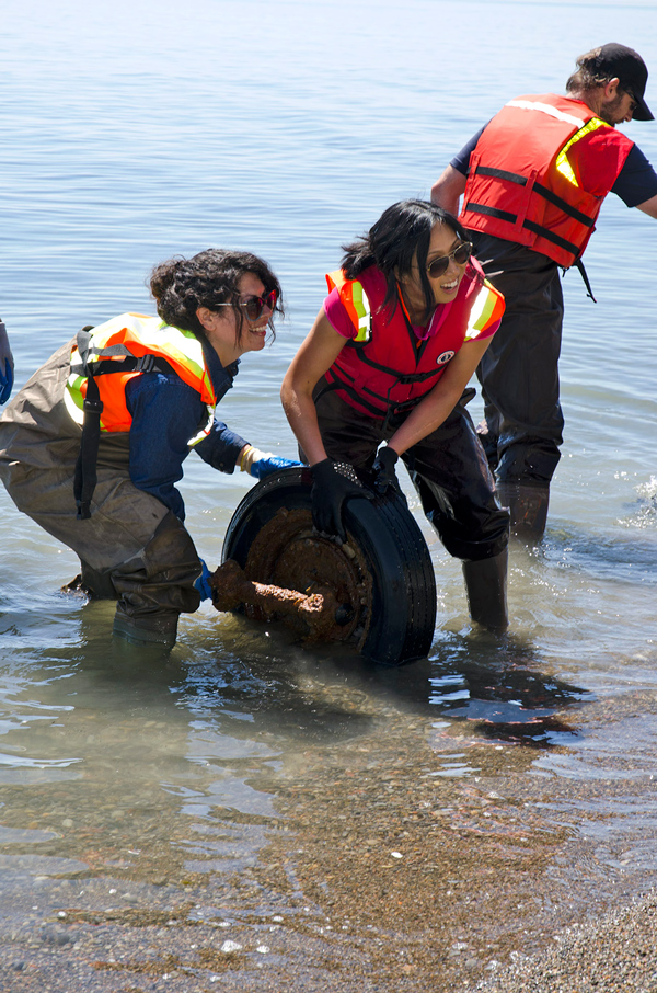 Volunteers pulled out many different objects from the water and sand during the shoreline cleanup at East Point Park in Scarborough, Ont. Much of the cleanup included removing car parts which had been dumped in the area.