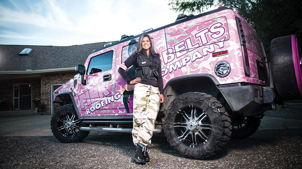 Pink Belts' all–female roof ing crew hangs out their shingle
