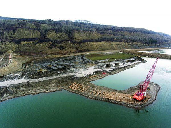 According to BC Hydro, construction work on the $10.7-billion, 1,100-megawatt Site C hydroelectric dam and generating station on the Peace River in northern British Columbia is moving ahead as planned. Pictured is in-river work taking place in April.