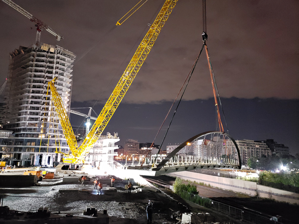 The bridge was supplied by Mariani Metal Fabricators and was lifted into place by one of the largest crawler cranes in North America, supplied by Sterling Crane Canada.