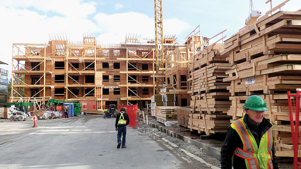 Large-scale condo developments such as Yorkson Creek Phase 2 by Reddale Construction Ltd. are turning to prefab wall units by Pro-Fit as a means of expediting construction.