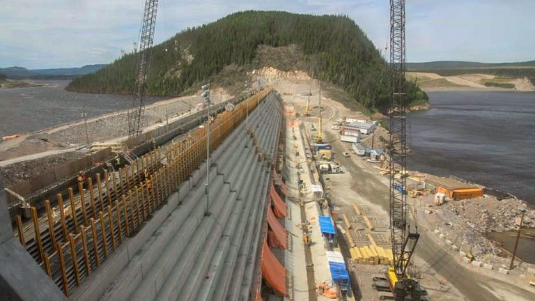 A public inquiry is underway for the massive Muskrat Falls hydro megaproject in Labrador. The project's budget has climbed to $12.7 billion. Pictured is construction on the North Dam.