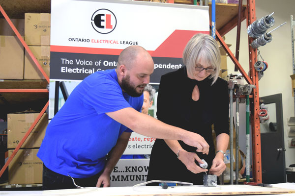 Ian Currell, an electrical apprentice in his fourth year of training, now working at Corlan Electric of Mississauga, challenged federal Minister of Employment, Workforce Development and Labour Patty Hajdu to perform a workshop task at a media event held Sept. 21.
