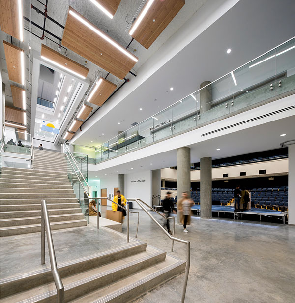 An atrium cuts through the centre of the new Emily Carr University bringing natural light into the building. The atrium floors are broken up by the installation of horizontal fire shutters.