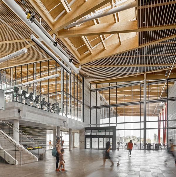 The roof system at the Aaniin Community Centre and Library in Markham, Ont. is comprised of glulam primary beams, glulam purlins and spruce-pine-fir decking. The project won an Institutional Wood Design Award.
