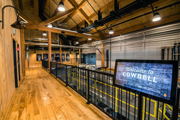 The timber-frame structure is visible throughout the interior of the Cowbell Brewing Co. facility in Blyth, Ont. The project won the Environmental Building Award in the 2018 Ontario Wood WORKS! wood design awards program.