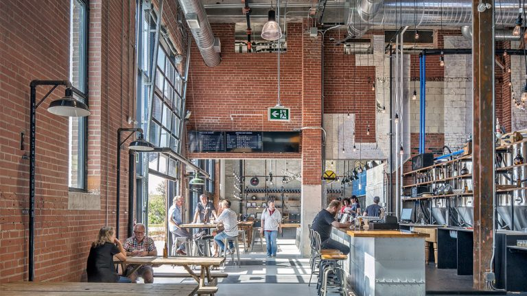 Junction Craft Brewing is now housed in a renovated industrial building in the Stockyards district of Toronto's west end. The company's 1,358-square-metre facility at 150 Symes Road contains a brewery, taproom, retail space and office space. The brewery project recently won an adaptive reuse award.