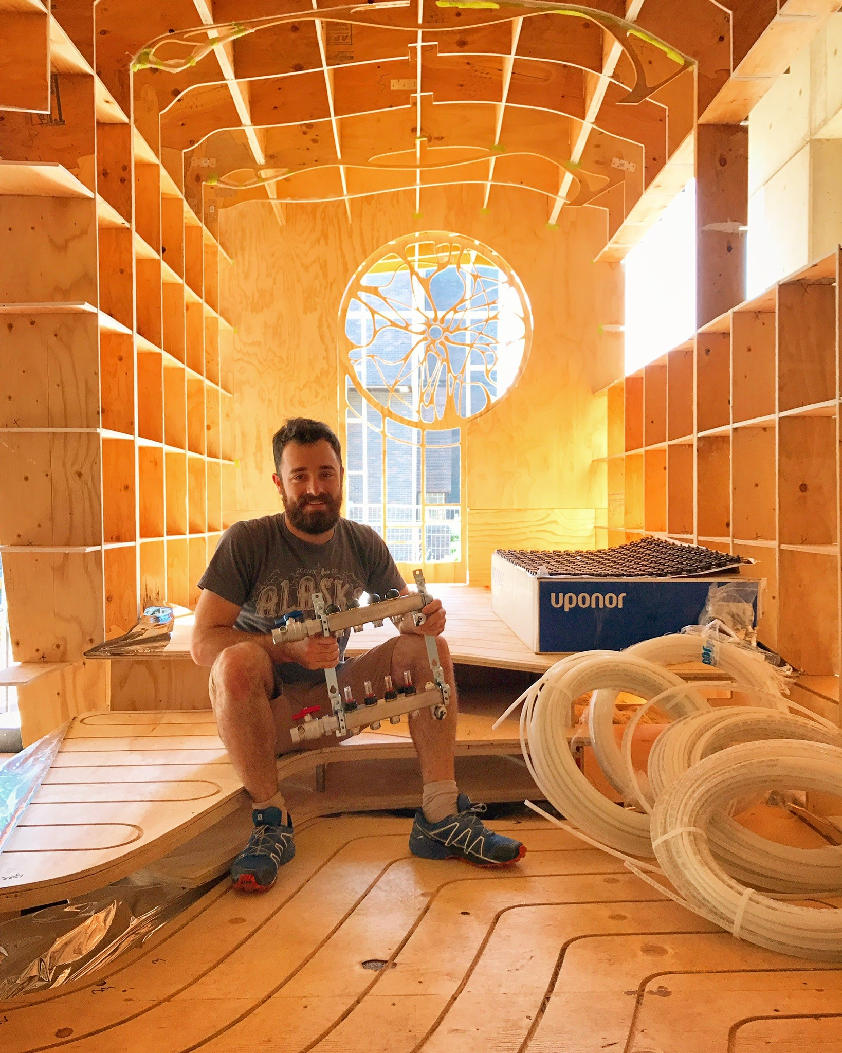 The interior of Ben Hayward's tiny home is designed in clean lines that give a visual impression of a larger space than the structure's actual size of 180 square feet.