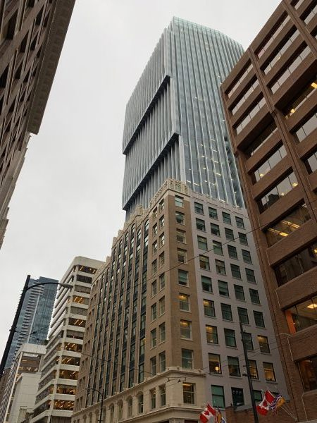 The 31-storey Exchange tower has preserved the facade of the original Vancouver Stock Exchange building and integrated it into the newer structure.