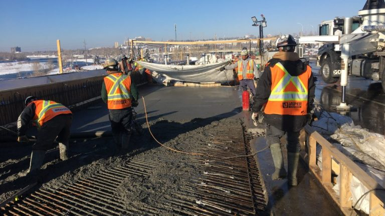 Crews pour a new lane on Crowchild Trail to add another lane to its crossing over the Bow River in Calgary. The team has had to get creative to keep the major route open while work is being done.