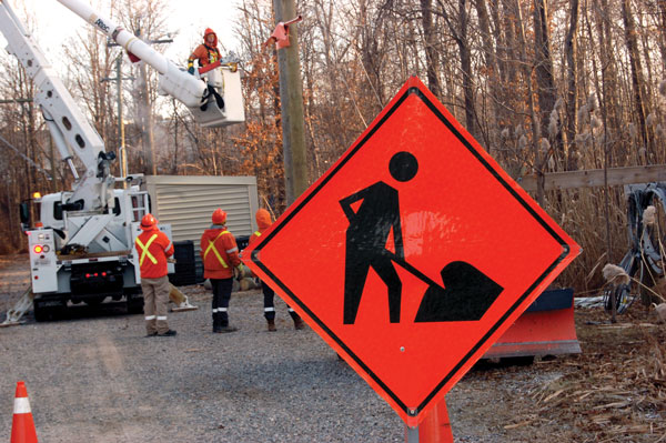 Linemen make their work area safe before other crew areas begin their assigned tasks. Construction warning signs are also used as part of an effort to simulate real working conditions.