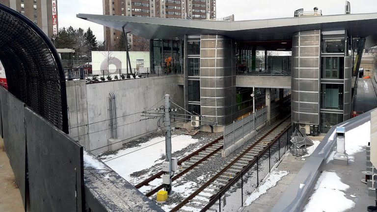 Work wraps up at Lees station, one of 13 stations on the 12.5-kilometre LRT route, in December. Ten kilometres of track run above ground and 2.5 kilometres underground with three stations located underground in the new downtown tunnel.