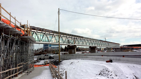 Construction of the stairs and ramp proceeded at the Coventry pedestrian footbridge during an earlier phase of the Ottawa LRT build.