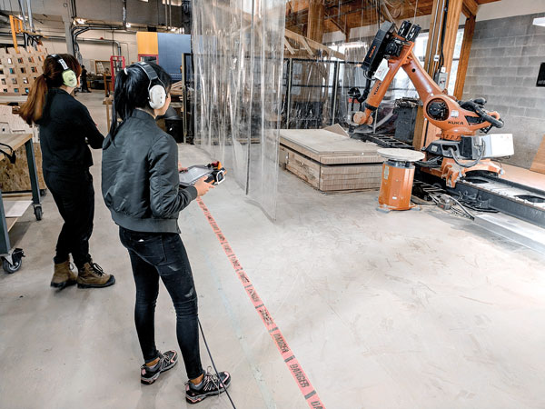 An eight-axis industrial robot was used to fabricate components of the Wander Wood installation at the university.