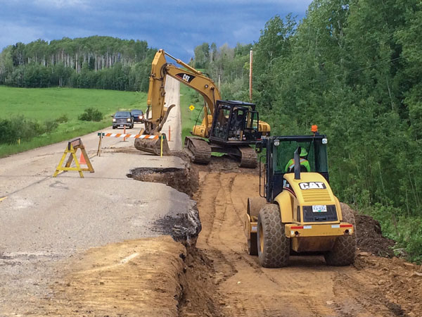 Crews work on Mason-Semple Road in June 2016 after rainfall caused road damage.