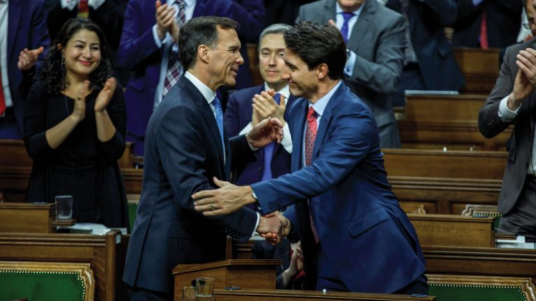 Federal Finance Minister Bill Morneau shakes hands with Prime Minister Justin Trudeau after unveiling the 2019 federal budget. One of the main items of the budget included a one-time $2.2-billion top-up to the federal Gas Tax Fund supporting municipal infrastructure.