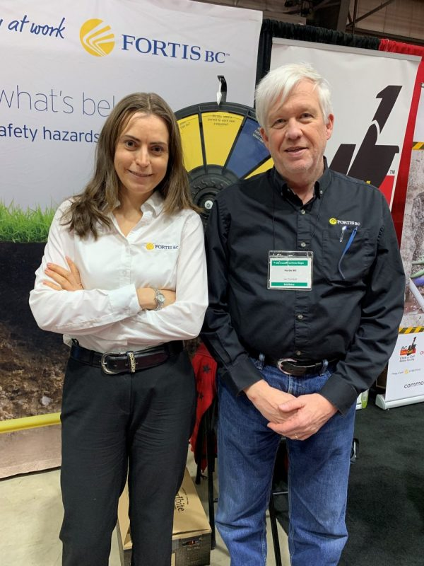 FortisBC manager of damage prevention and emergency services Ian Turnbull explained the procedures and potential peril involving the company's underground gas pipeline network to an audience of builders at the fourth annual Construction Expo in Cloverdale, B.C. From left, FortisBC public safety manager Michelle Petrusevich poses with Turnbull at a booth during the expo.