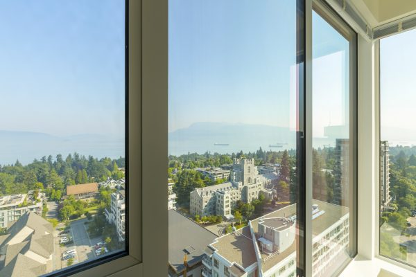 Boats and mountains are seen in the distance from a view high in Brock Commons, a residence at the University of British Columbia's Vancouver campus. The school recently examined all of its buildings to assess their seismic needs and plan upgrades.