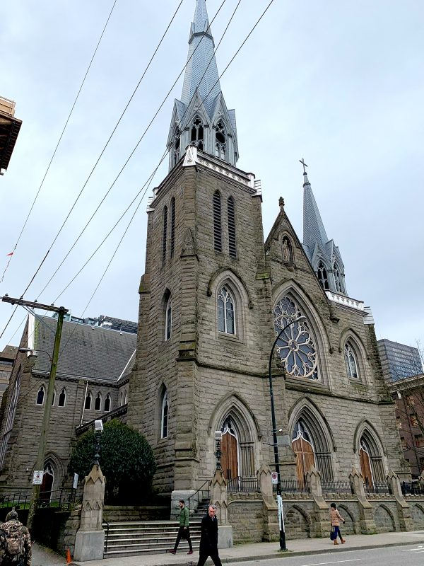 The Holy Rosary Cathedral in downtown Vancouver may see a new neighbour in an 18-storey tower built behind the church on the site where an existing rectory and youth activity centre stand.