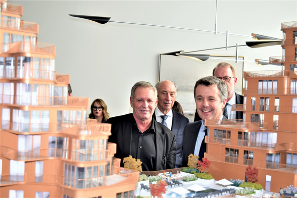 Crown Prince Frederik of Denmark visited the Bayside Toronto presentation centre on Toronto's waterfront March 4 to launch a new architectural exhibition presenting global waterfront projects and also unveil a model of the 10-storey T3 wood office building designed by Danish firm 3XN, which is being developed by Hines. Pictured, the prince (right) checks out a model for the fourth residential building at Bayside, the Aqualuna, also designed by 3XN, as 3XN founding principal Kim Herforth Nielsen (left) and Leo DelZotto, president and CEO of Aqualuna builder Tridel (centre) look on.