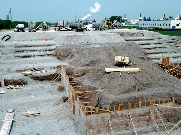 This photo shows the western abutment and future Canada Customs plaza footprint which will eventually become part of the new Gordie Howe International Bridge, with two batch plants and cavities to be filled with cellular concrete and expanded polystyrene blocks.