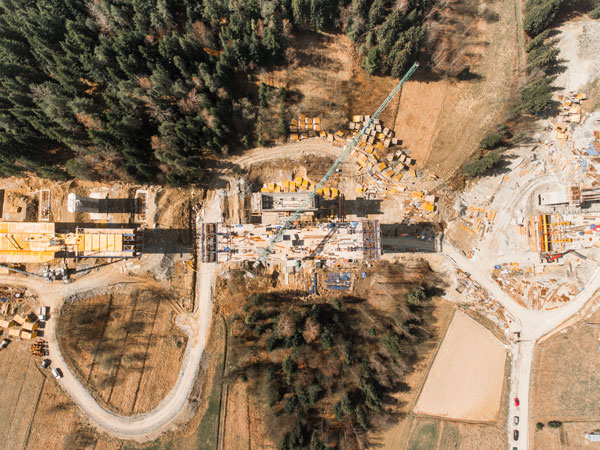 The use of drones for roadbuilding project sites has picked up considerably, say experts. Drones can provide engineers with overviews of projects like this image captured by a drone of a bridge and highway project site.