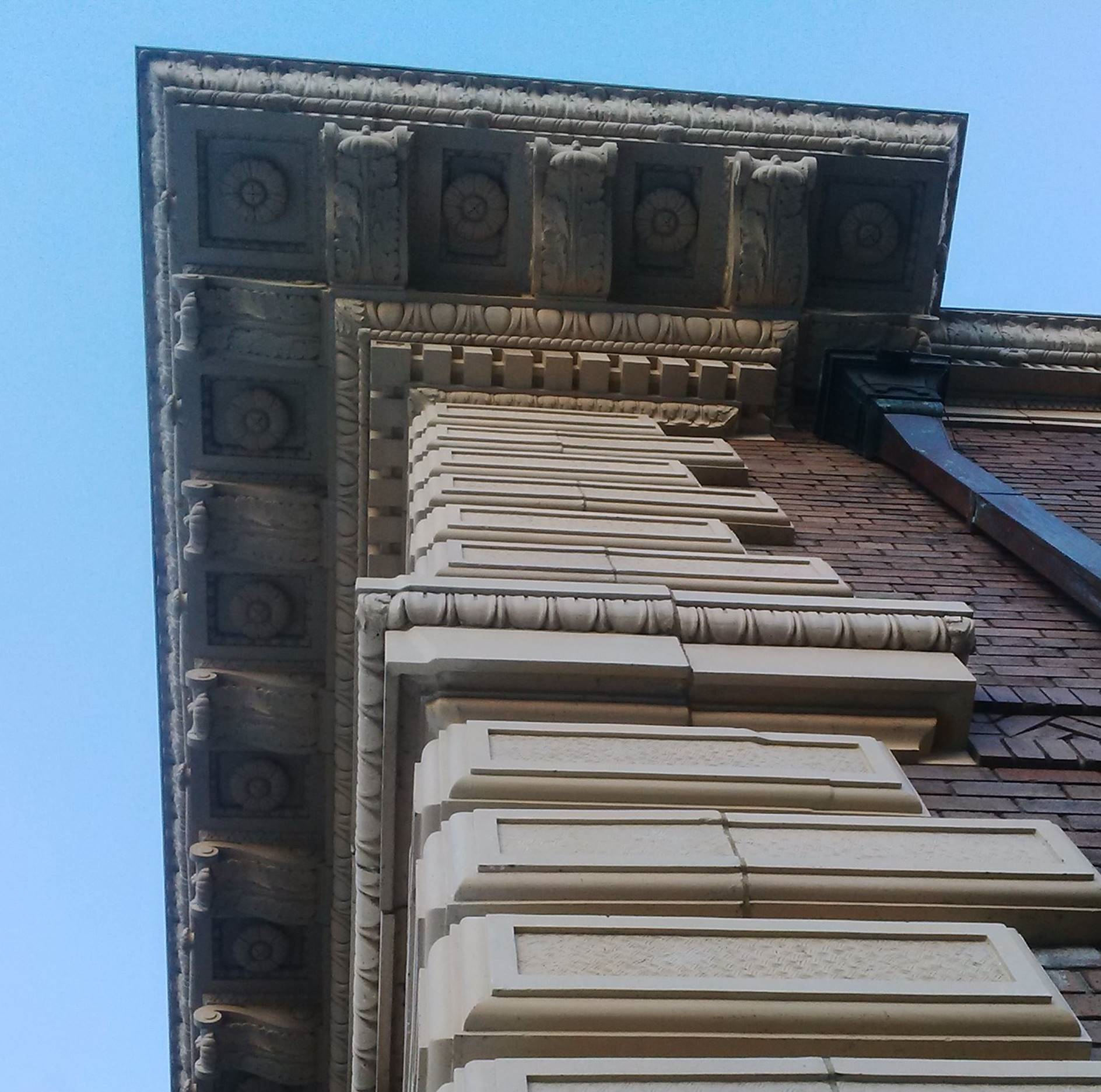 Among the work done was the careful dismantling of the building's terra cotta while cataloging the various elements so they could be carefully pinned back together, patched along cracks, sanded, stained and installed to original state. Decorative rosettes were installed in openings left void for nearly 100 years.