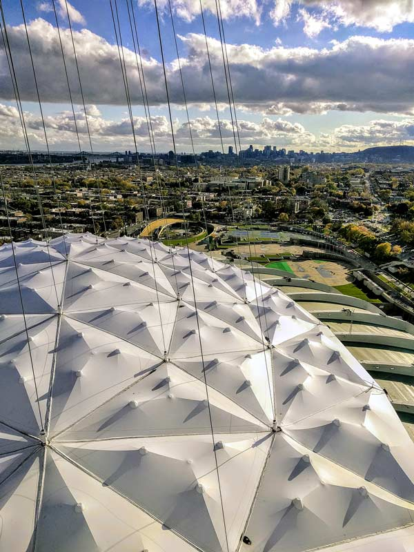 The second roof for the Olympic Stadium in Montreal designed by Birdair is non-retractable and features 93 panels of Teflon covered with fiberglass resting on a lattice of steel cables.
