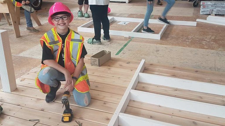 Attendees at Thompson Rivers University's Carpentry Camp For Girls in B.C. build a playhouse.