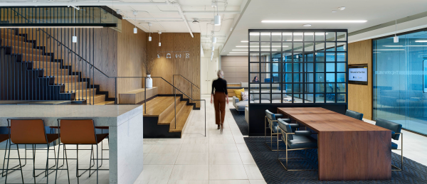 In order to create opportunities for employers to engage in casual collisions and stay connected, BentallGreenOak installed a staircase from the 12th to the 11th floor at its new offices at One York in Toronto, with the landing area near the reception area featuring casual meeting places near the coffee machine.