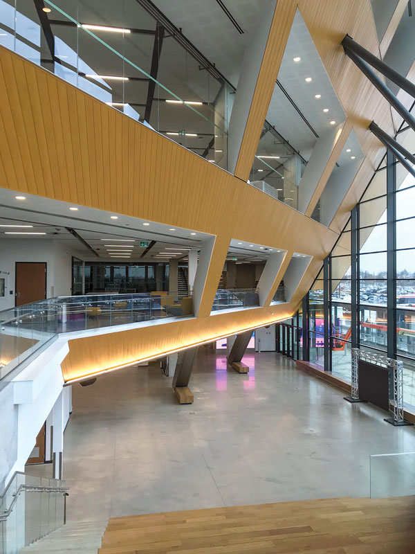 A view of the lobby space in the Barrett Centre looking towards the collaborative break out spaces incorporated in the building along its mezzanine edges.