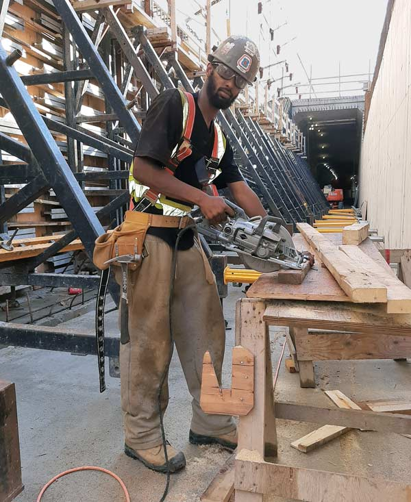 "The Eglinton Crosstown LRT project has kept second-year carpenters' apprentice Abdirahman ""Abdi"" Mohamed busy at the start of his carpentry career. He credits the eight-week formwork course at the College of Carpenters and Allied Trades for sparking his interest in the trade."