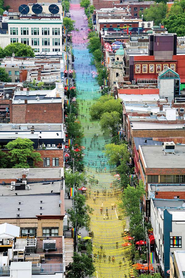 18 Shades of Gay, a one-kilometre-long ribbon-like installation of 180,000 multicoloured resin balls suspended over Sainte-Catherine Street East, in the Gay Village of Montreal, is part of the transformation of the street into a pedestrian mall during the summer.