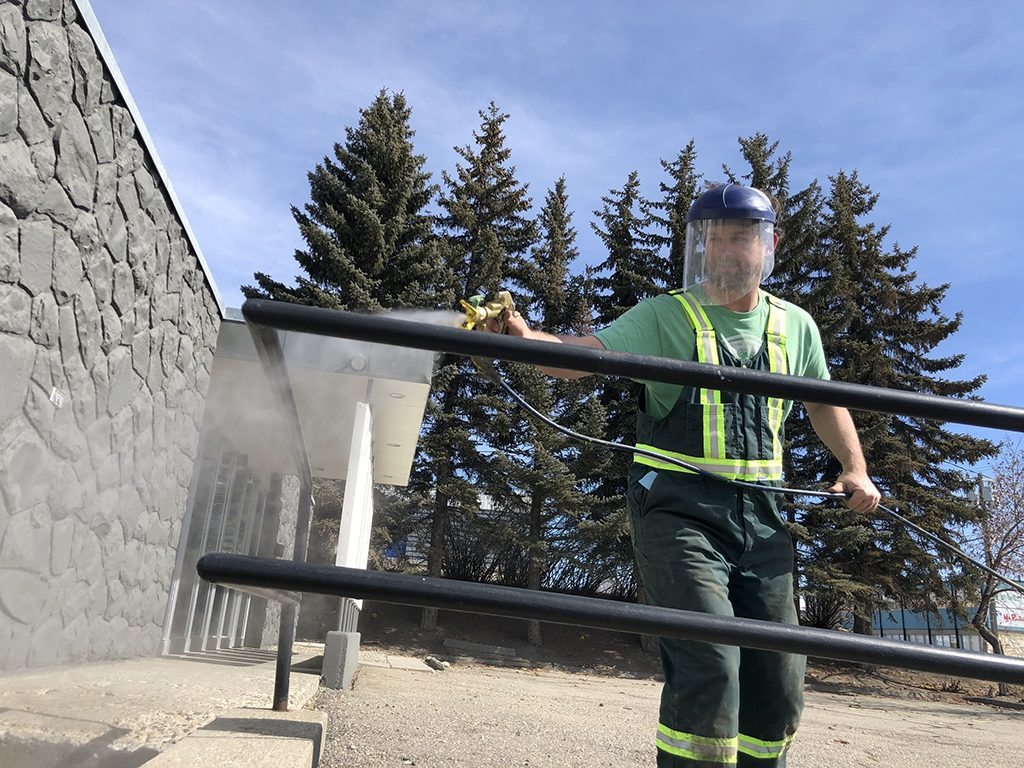 Road painters convert gear to spray virus-killing disinfectant