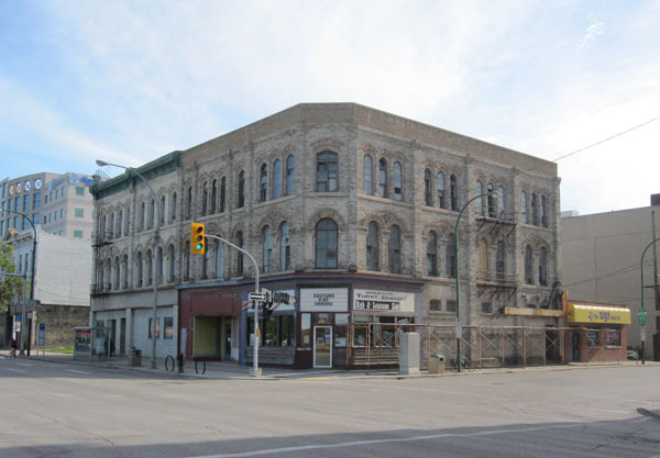 "Alpha Masonry Ltd. was recognized for its masonry work on the Fortune Building's exterior and for its ""sympathetic undertaking"" of the removal of paint, the restoration work of the exterior brick and the extensive repointing. Pictured here is the building before work was done."
