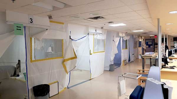 The field hospital set up in the St. Clair College SportsPlex for the Windsor Regional Hospital in Windsor, Ont. commenced in March with the installation of barriers and other infection control measures around the facility before the construction crew installed 10-by-10-foot cubicles for each patient.