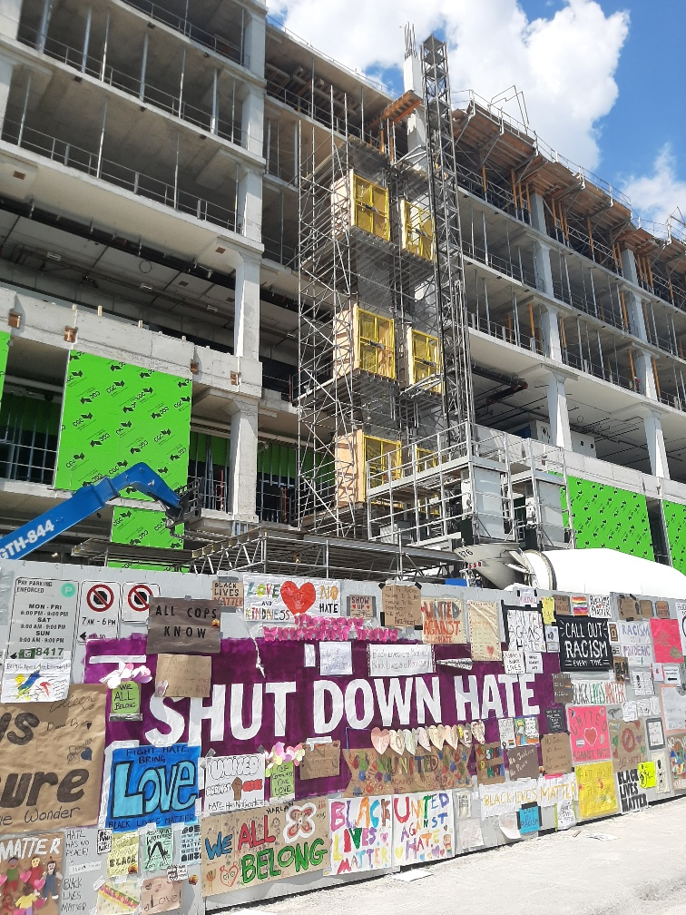 """Posters surround a large message that says """"Shut Down Hate"""" at the Michael Garron Hospital construction site. This comes after a noose was found by workers at the site on June 10."""
