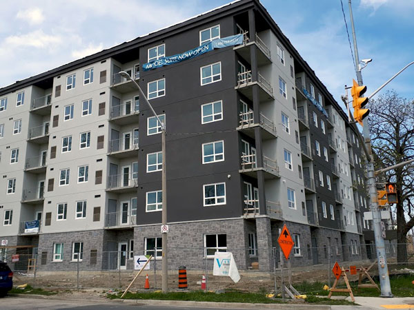 Pictured is the exterior of West Bridge Place in central Windsor, Ont., which is slated to be finished later this summer. It is the first highrise residential tower in the city's centre in three decades.