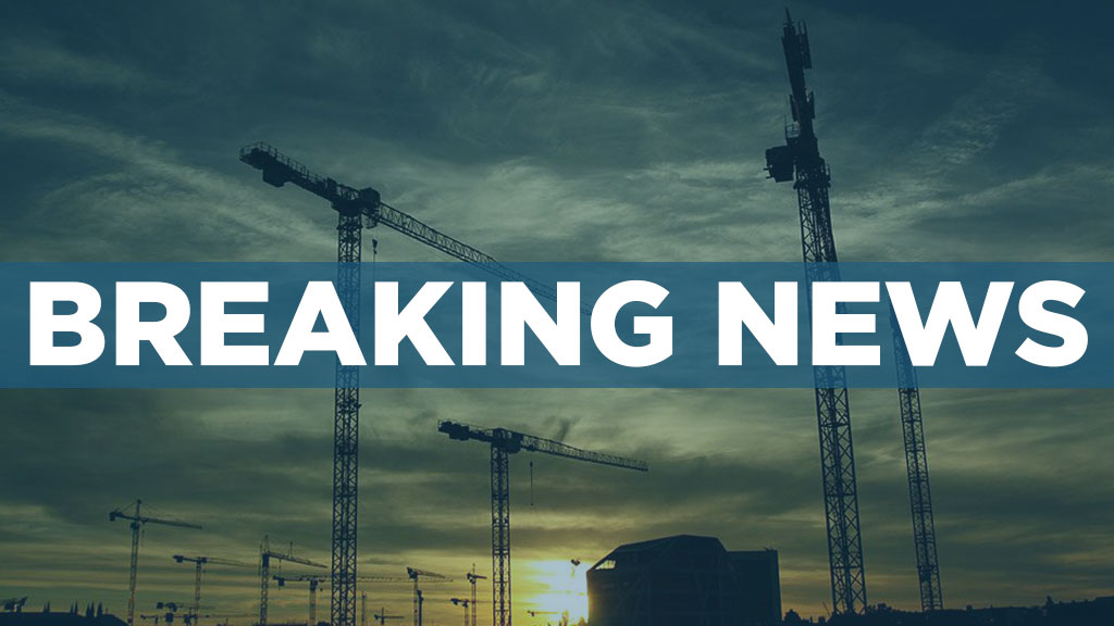 BREAKING NEWS UPDATE: Crane hits building in Toronto, minor injuries reported