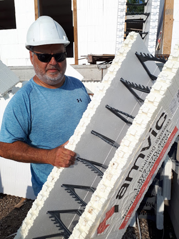 Jim Liovas, of Liovas Homes in Leamington, Ont., shows off the innovative Amvic insulated concrete form block system that is being used on a $20-million, 16-building development on Leamington's east side that will eventually house as many as 600 migrant workers who work for Highline Mushrooms.