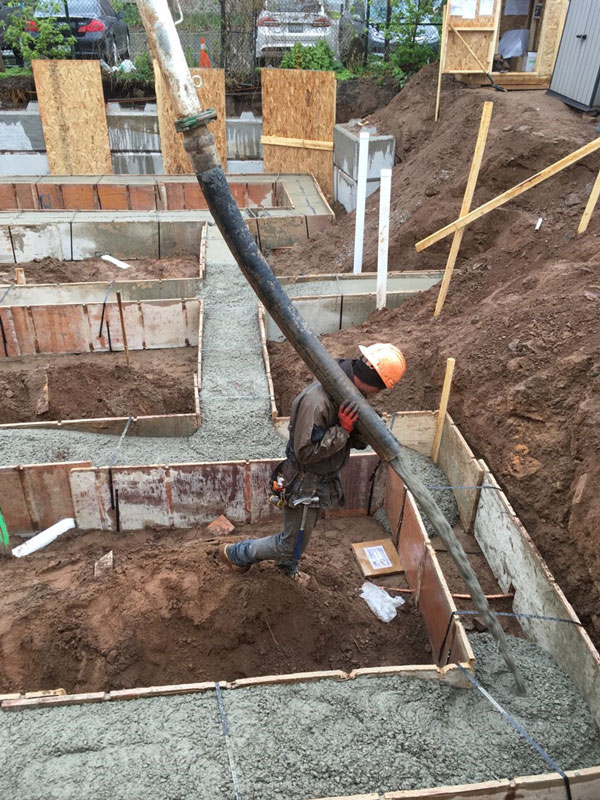 A worker from Tri-Star Forming oversees a pour at the Habitat Hamilton site on Catharine Street North in Hamilton. The duplex project has been adopted by the Hamilton-Halton Construction Association as its 100th-anniversary Legacy Build.