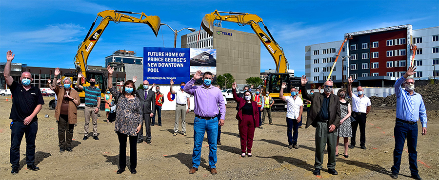Officials wave during the groundbreaking for a new aquatics centre in downtown Prince George, B.C.
