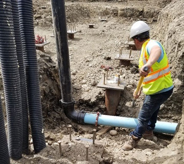 Initial work for the RCMP detachment involved installing underground infrastructure, which included pilings and grade beams, and a series of wells to support a geothermal exchange system that uses the earth's energy to heat or cool the structure.