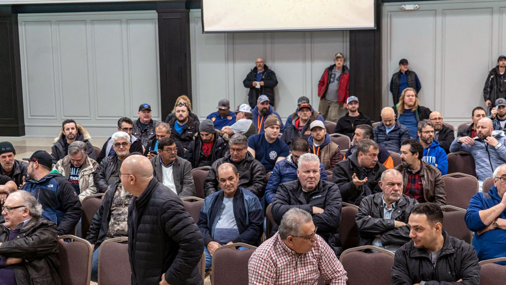LIUNA International vice-president Joe Mancinelli is concerned that many of the union's 130,000 national workers will be shut out of access to the federal government's approved COVID Alert contact tracing app because smartphones are not permitted on many worksites. Pictured: LIUNA members attending a Local 183 meeting in February.