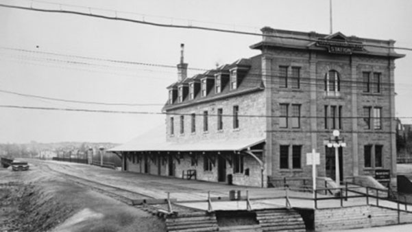 A historical photo shows the St. Mary's Parish Hall/CNR Station in Calgary. The building is now the city's 100th Municipal Historic Resource, a designation that aims to keep significant buildings preserved.